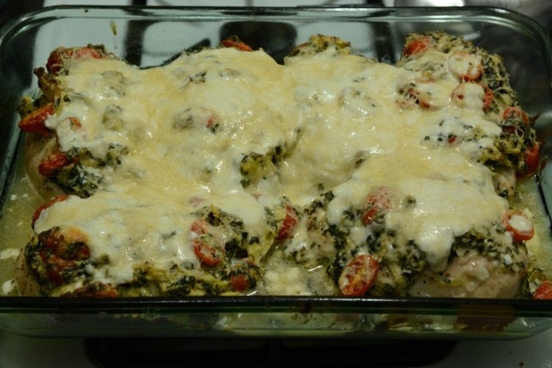 Finished Chicken Stuffed and Topped with Spinach Artichoke Dip