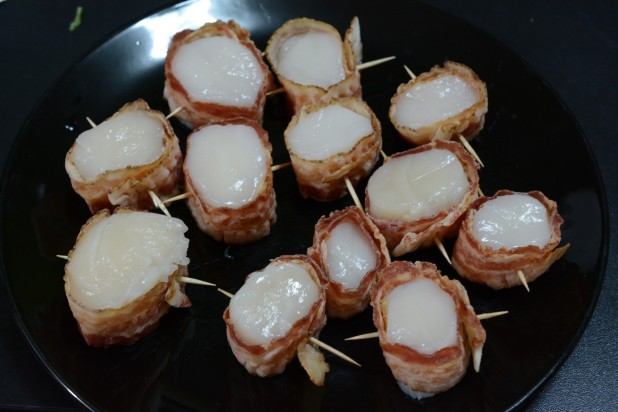 Scallops wrapped with Bacon ready for frying