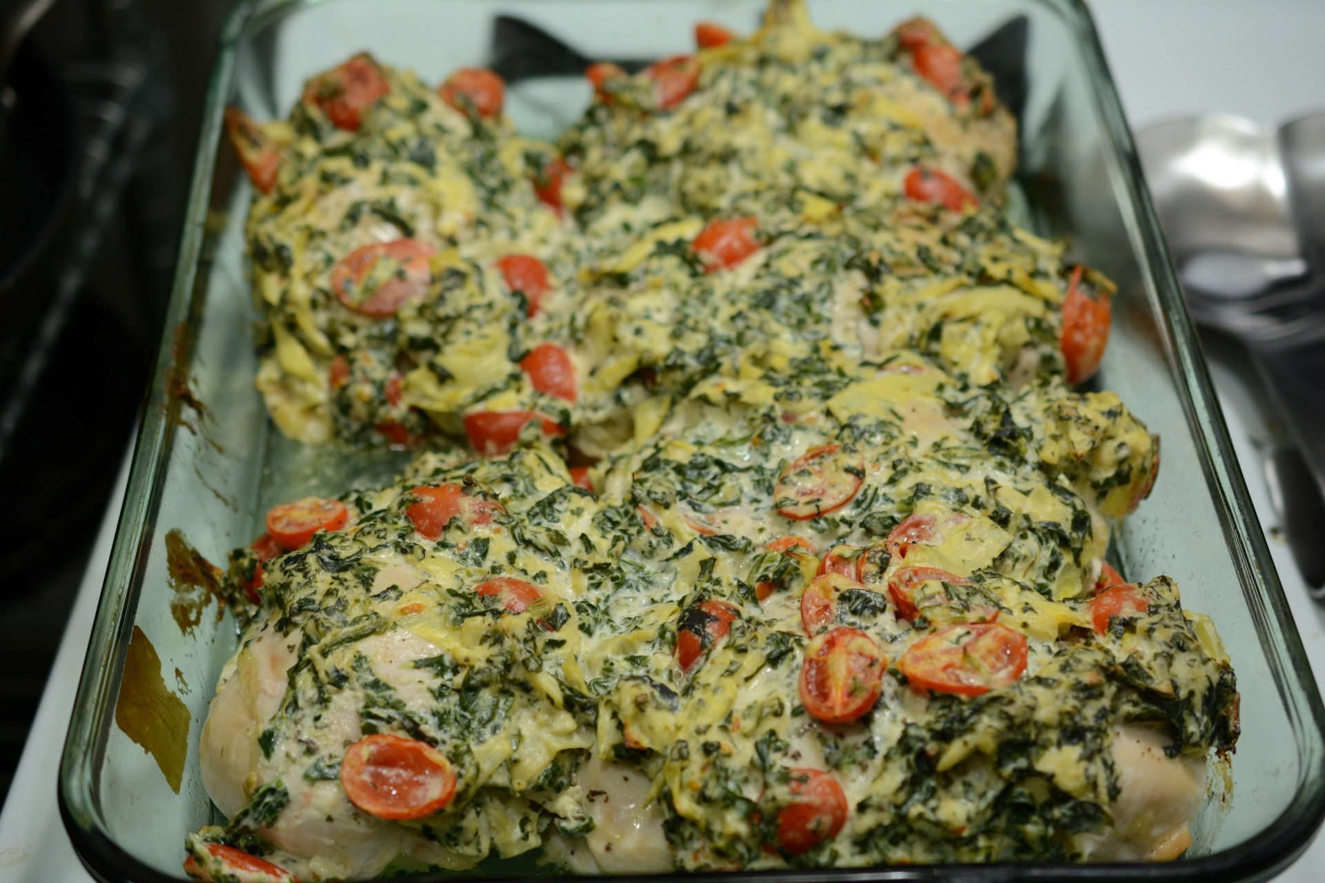 Chicken Stuffed And Topped With Spinach Artichoke Dip Caveman Keto